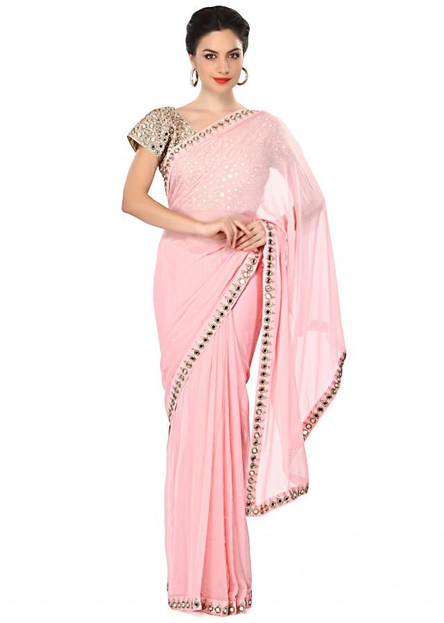 Seashell pink saree embellished in sequin and mirror embroidery only on Kalki