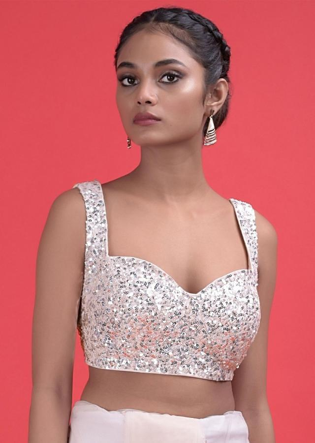 Baby Pink Saree In Net With Floral Buttis In Sequins And A Sequins Embellished Blouse Online - Kalki Fashion