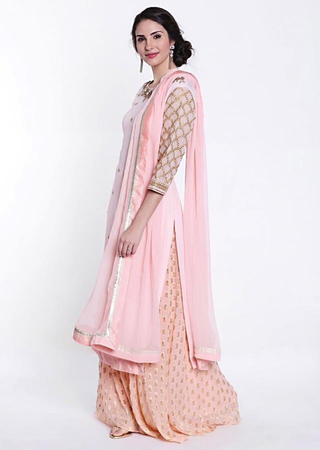 Baby pink straight palazzo suit with embroidered neckline only on Kalki