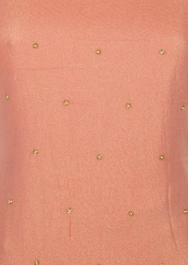Baby peach unstitched suit in shimmer georgette embellished in moti and cut dana work only on Kalki