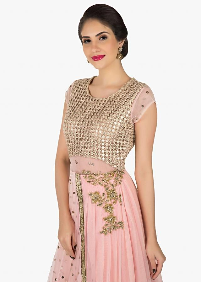 Baby pink gown saree in net enhanced in fancy cut work fabric only on Kalki