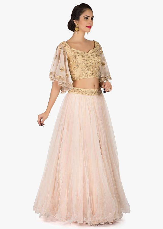 Baby Pink lehenga in net with a ready blouse flaunting the bell sleeves in Zardosi only on Kalki