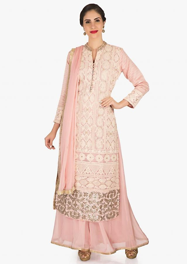 Baby pink palazzo suit in georgette featuring the heavy thread and gotapatti work only on Kalki
