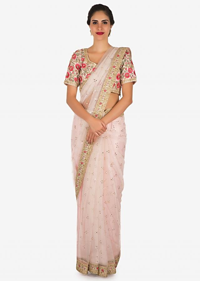 Baby pink saree in net with a ready raw silk blouse beautified in resham work only on Kalki