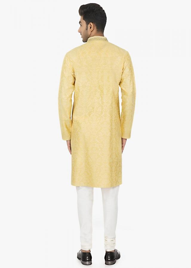 Banana Yellow full sleeves kurta matched with white polyester silk chudidar set only on Kalki