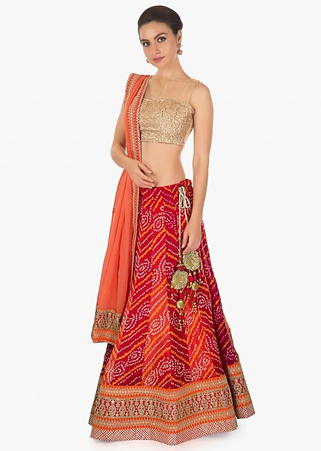 Bandheni georgette lehenga with alternate kali matched with peach georgette dupatta only in kalki