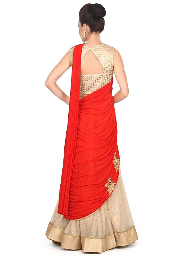 Beige and red saree gown enhanced in embroidered pallav only on Kalki
