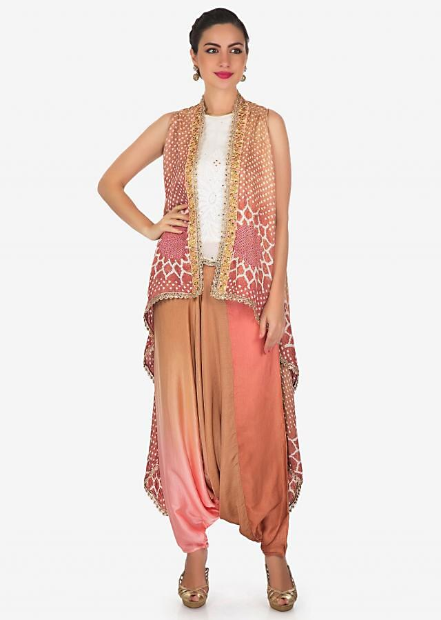 Begie and peach dhoti suit matched with bandhani printed jacket only on Kalki