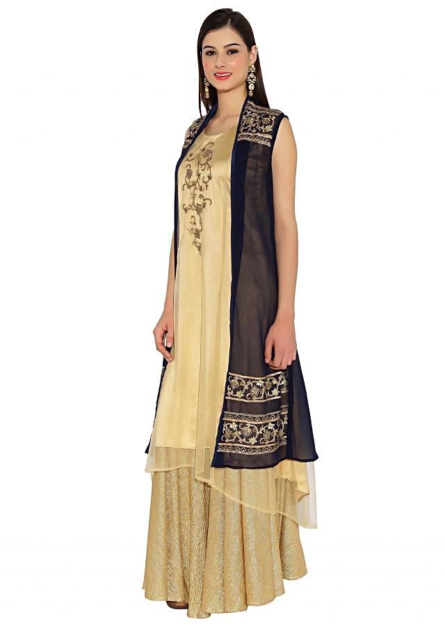 Beige and navy blue kurti in zari embroidered butti and hem line