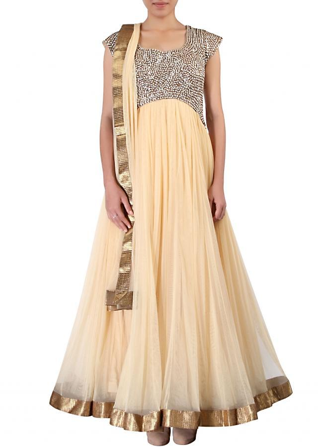 Beige anarkali suit adorn in kundan and sequin embroidery only on Kalki