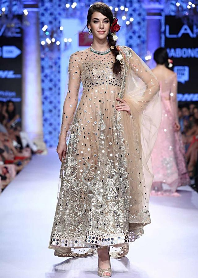 Model walks the ramp in beige anarkali with mirror and resham embroidery for Suneet Verma for his collection Decorative Arts of India at Lakme Fashion Week Summer Resort 2015