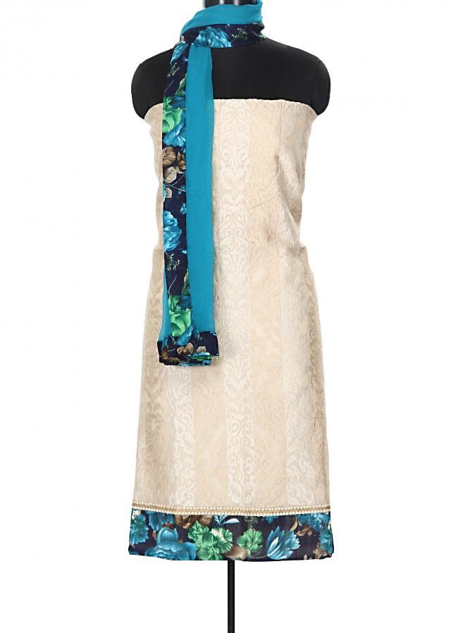 Beige and blue unstitched suit enhanced in thread and printed hem line