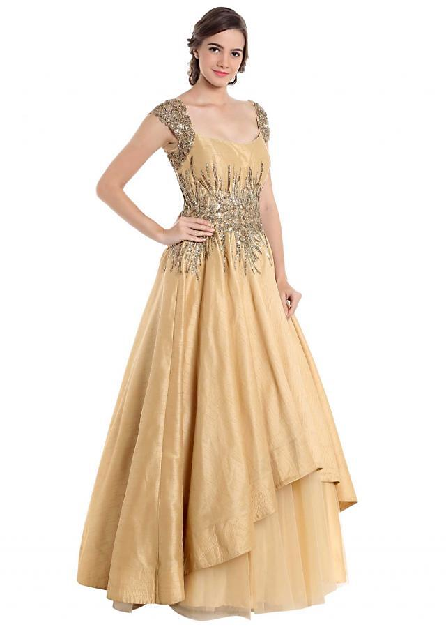Beige and gold gown crafted with sequins and zari only on Kalki