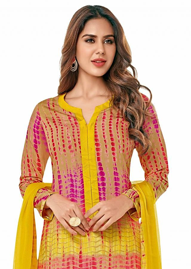 Beige and pink straight suit in batik print only on Kalki