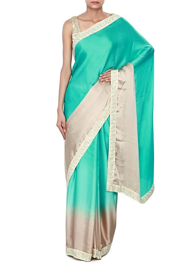 Beige and sea blue shaded saree enhanced in kundan embroidery only on Kalki