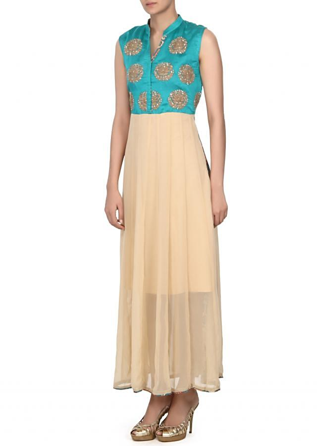 Beige and turq kurti embellished in french knot embroidery only on Kalki
