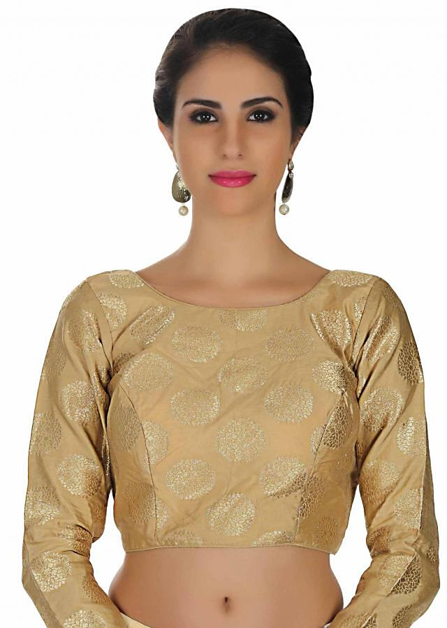 Beige blouse in borcade with round neckline and 3/4 sleeve only on Kalki