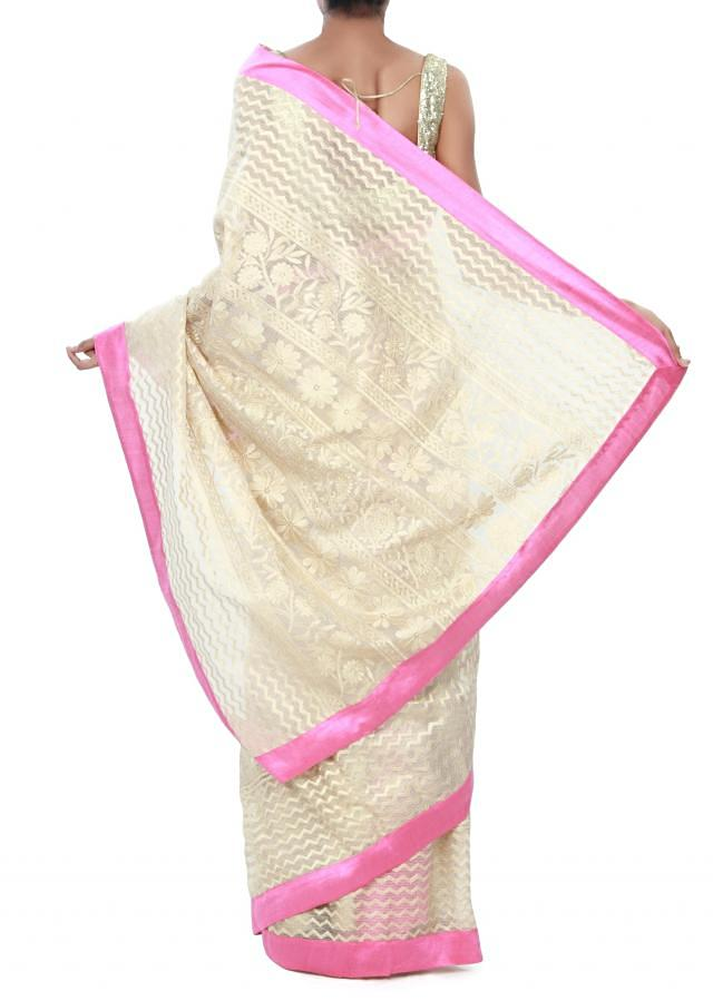Beige chanderi silk saree embellished in floral thread embroidery only on Kalki