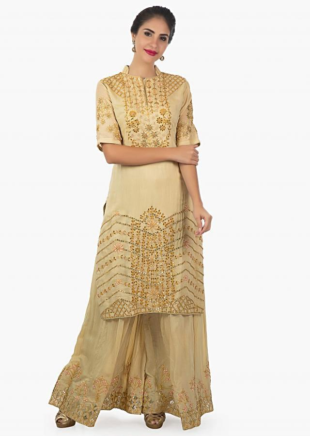 Beige cotton palazzo suit embellished in zardosi and moti with a chiffon dupatta only on Kalki