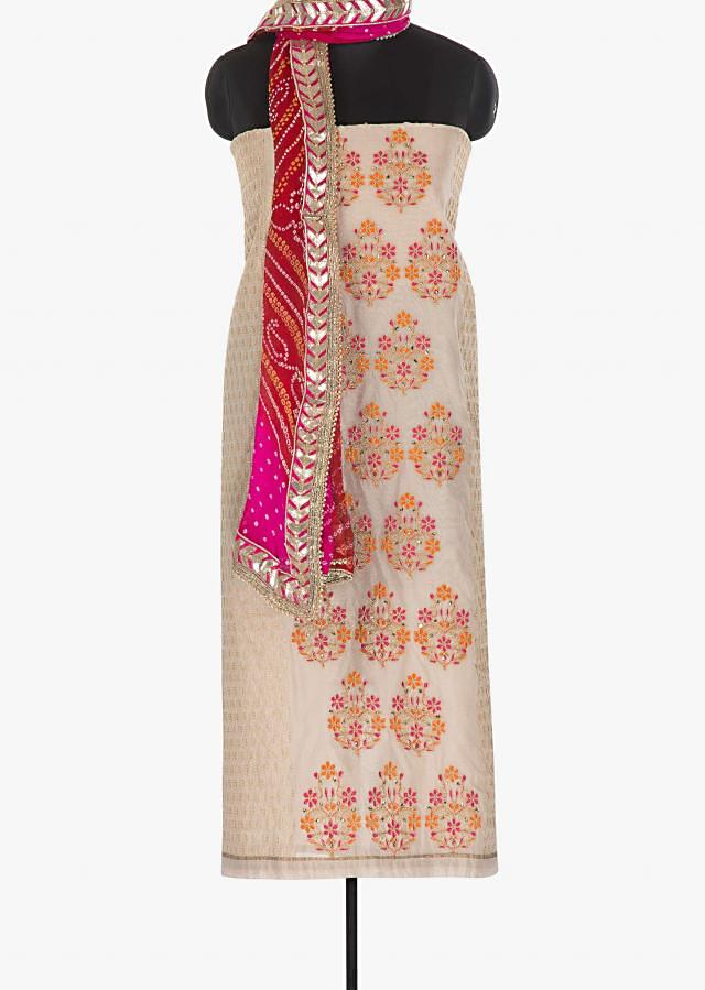 Beige cotton unstitched suit in resham embroidered butti only on Kalki