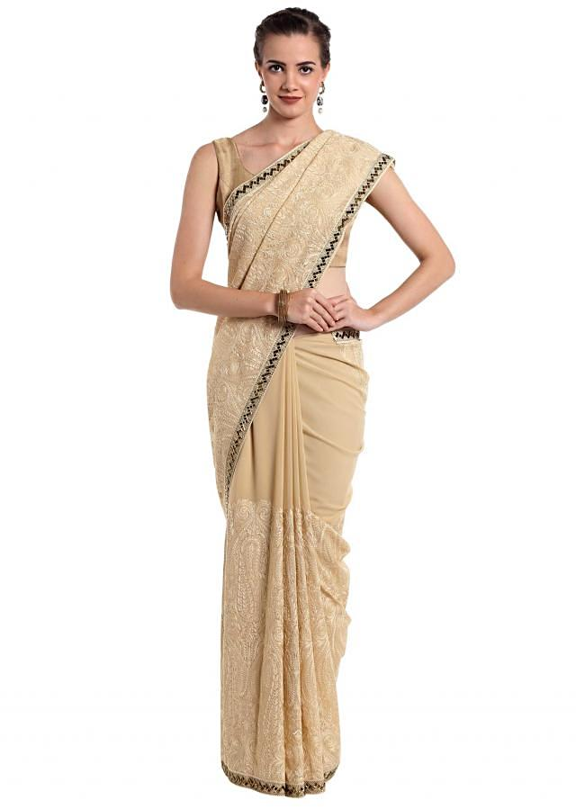 Beige georgette saree adorned with thread work  only on Kalki