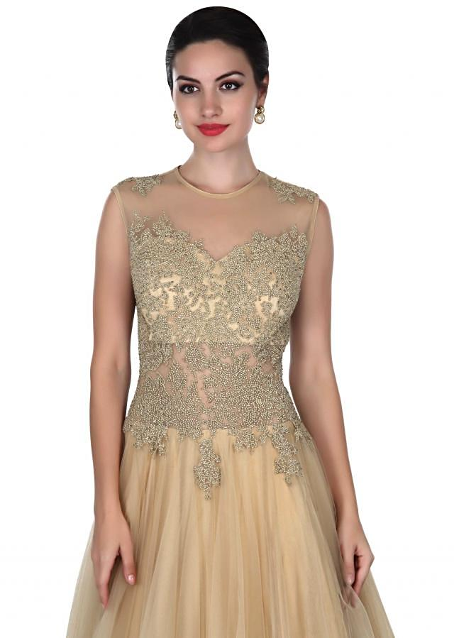 Beige gown adorn in embossed zari embroidery only on Kalki