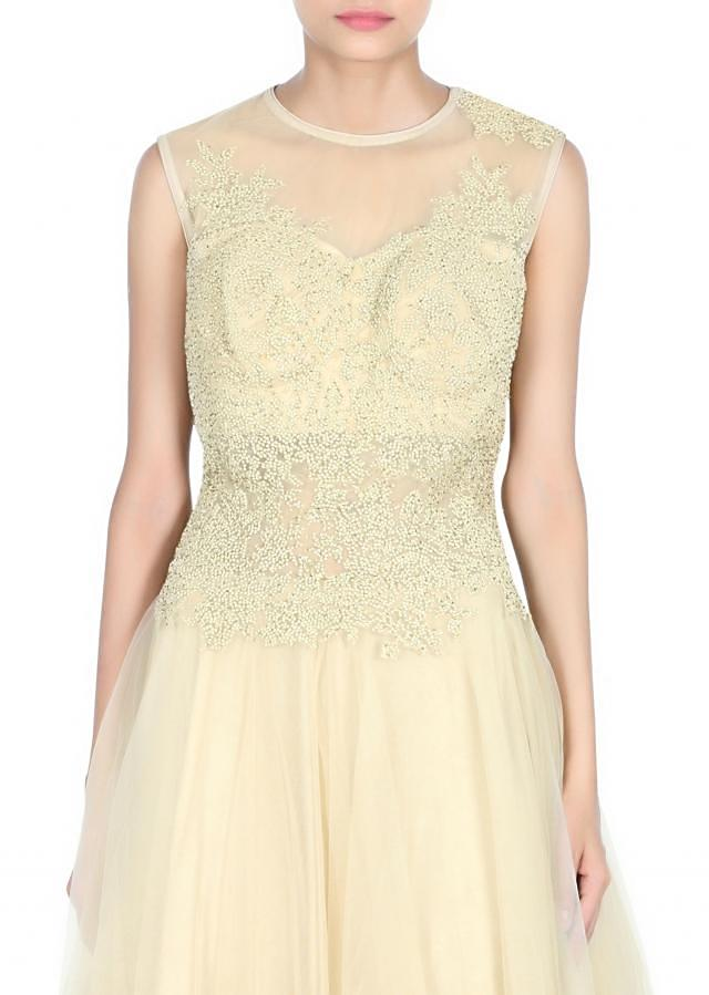 Beige gown embellished in embossed zari embroidery only on Kalki