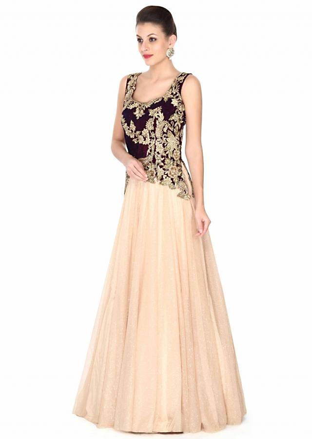 Beige gown features with zari embroidered bodice only on Kalki