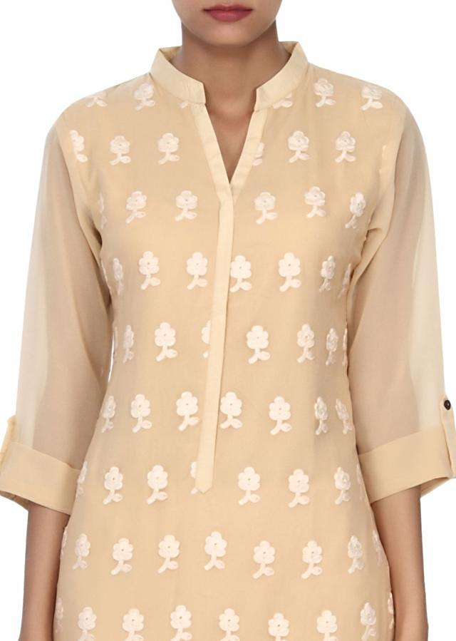 Beige kurti adorn in resham embroidery in floral butti only on Kalki