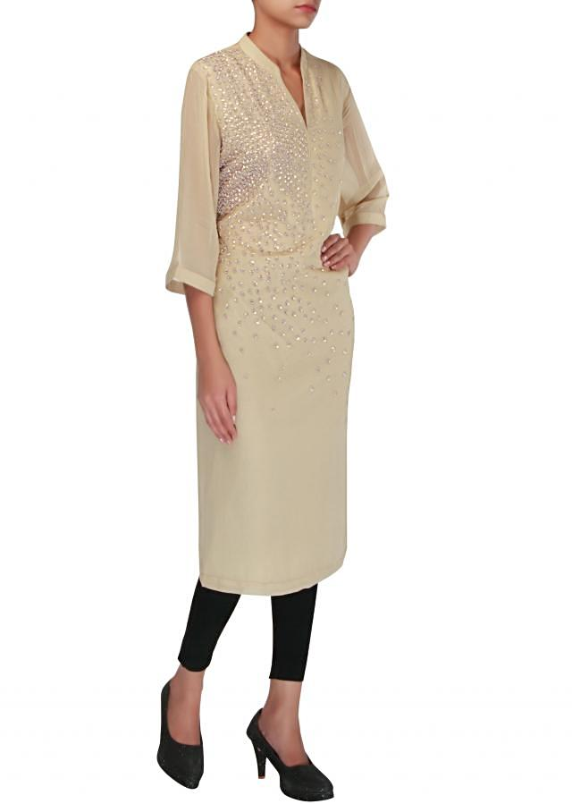 Beige kurti embellished in sequins only on Kalki
