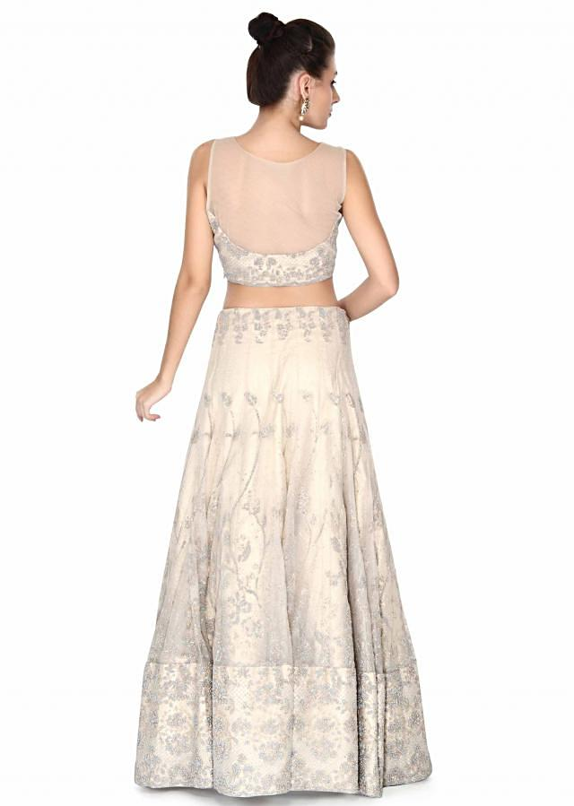 Beige lehenga adorn in blue moti embroidery only on Kalki