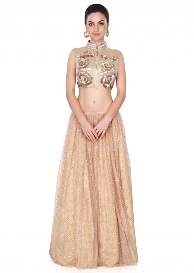 Beige lehenga adorn in sequin embroidery in floral motif only on Kalki