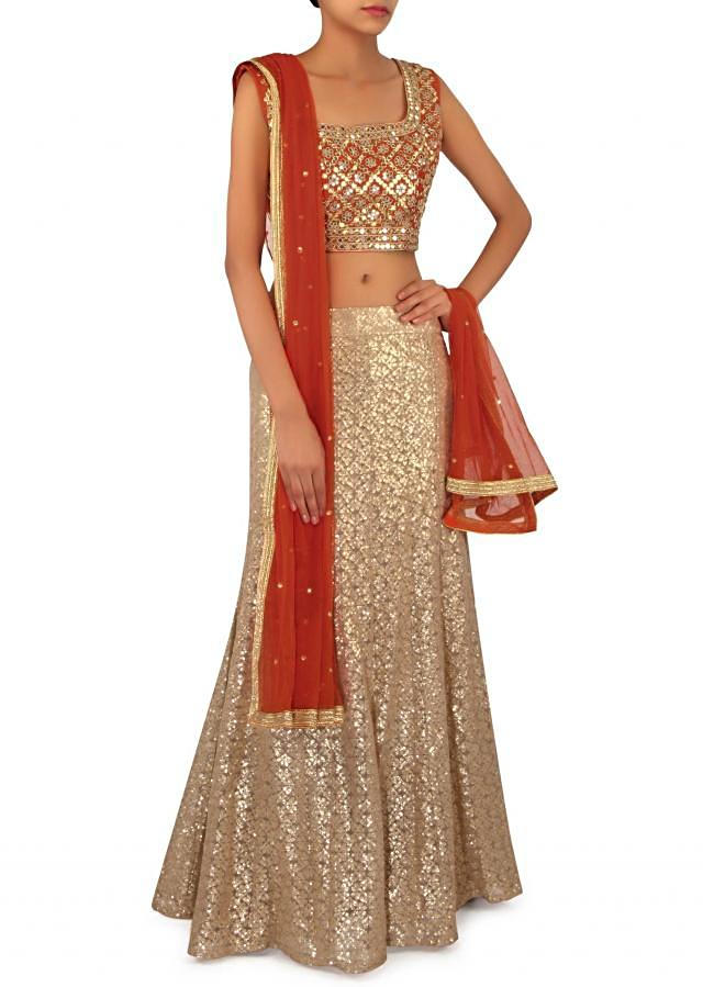 Beige lehenga and orange blouse in gotta and sequin only on Kalki
