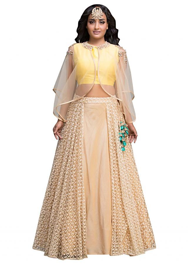 Beige lehenga features with bead embroidered cape