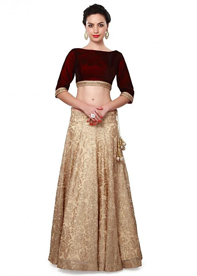 Beige lehenga features with zari embroidery only on Kalki