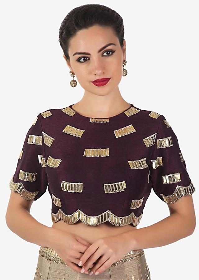 Beige lehenga matched with maroon blouse and pre stitched dupatta only on Kalki