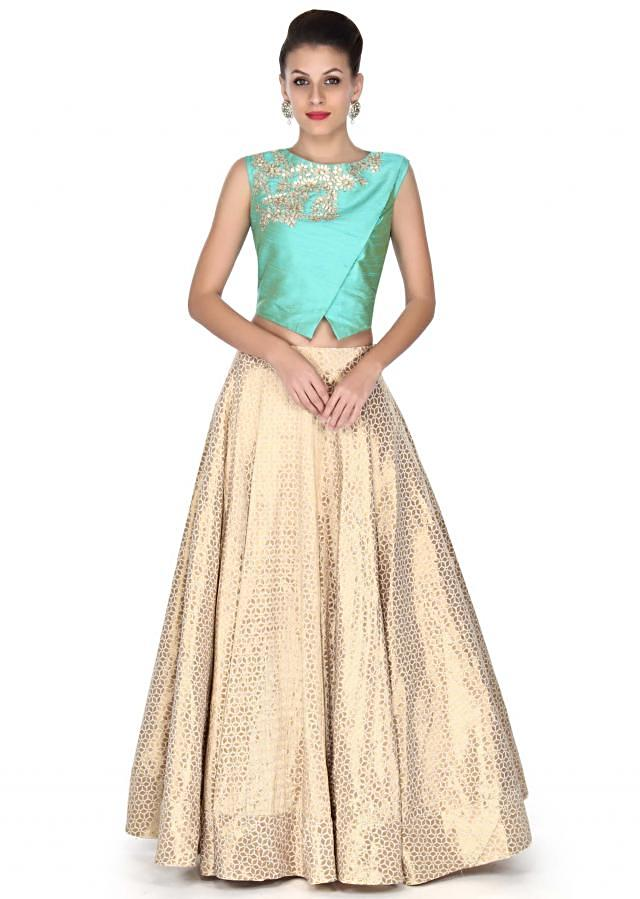 Beige lehenga with blue blouse in zari embroidery only on Kalki