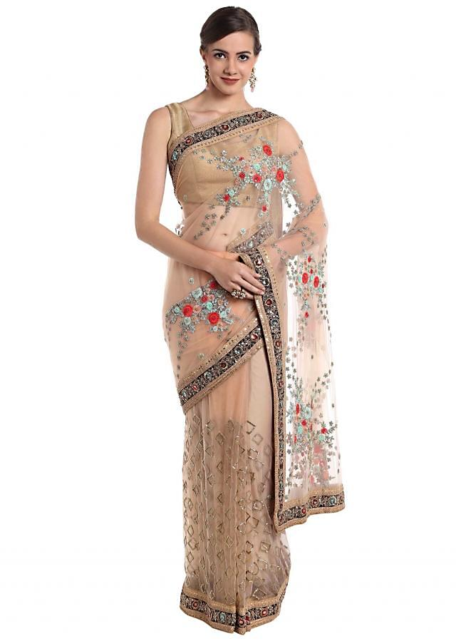 Beige net saree crafted with resham and cut dana work only on Kalki