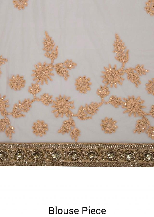 Beige net saree in lucknowi thread work only on Kalki
