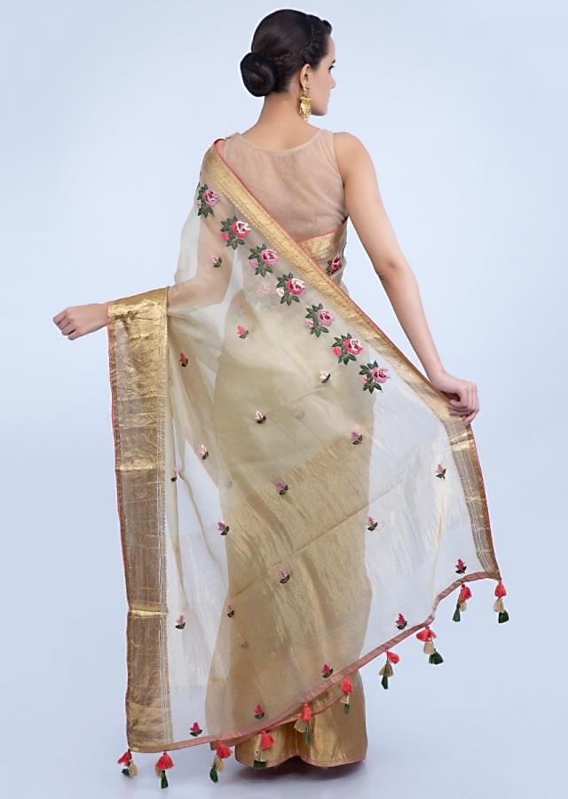 Beige organza saree with floral embroidered butti and border only on Kalki