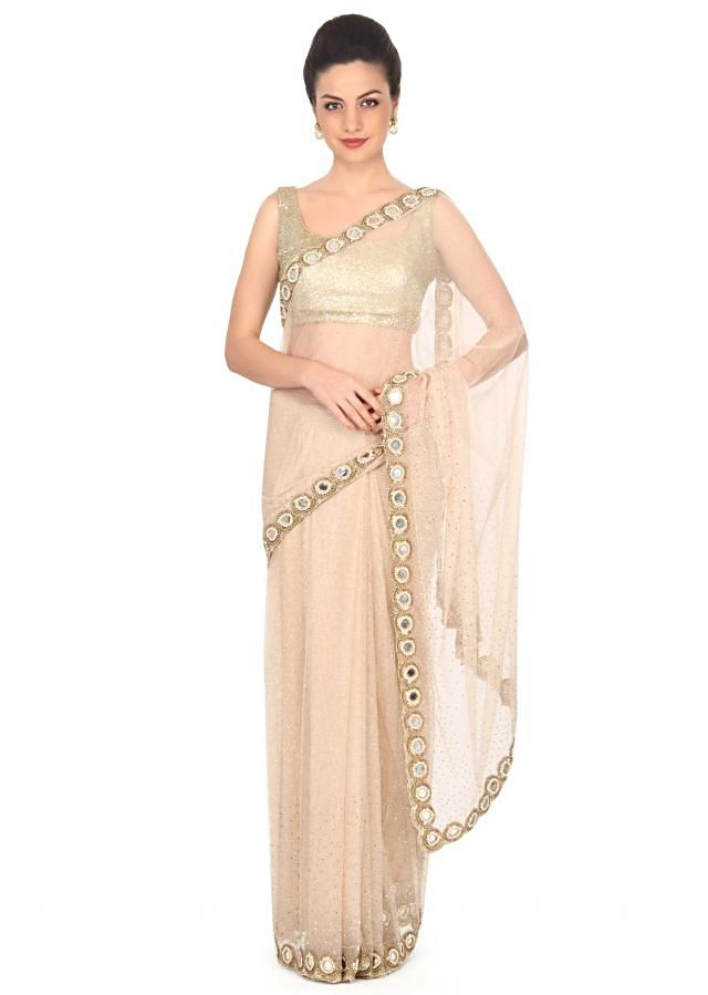 Beige saree adorn in kundan and mirror border only on Kalki