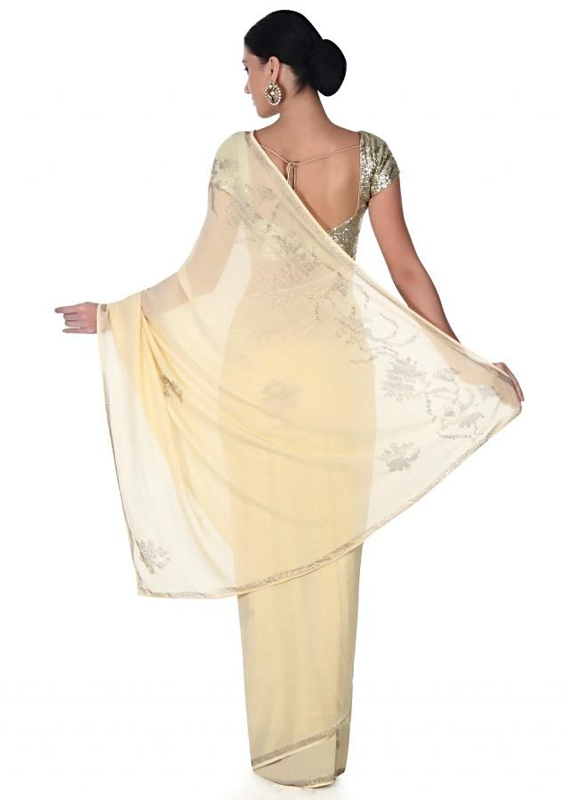 Yellow beige saree adorn in kundan butti and border only on Kalki