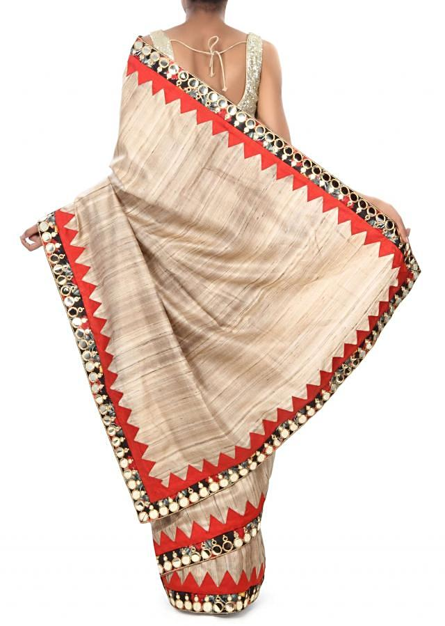 Beige saree adorn in mirror and printed border only on Kalki