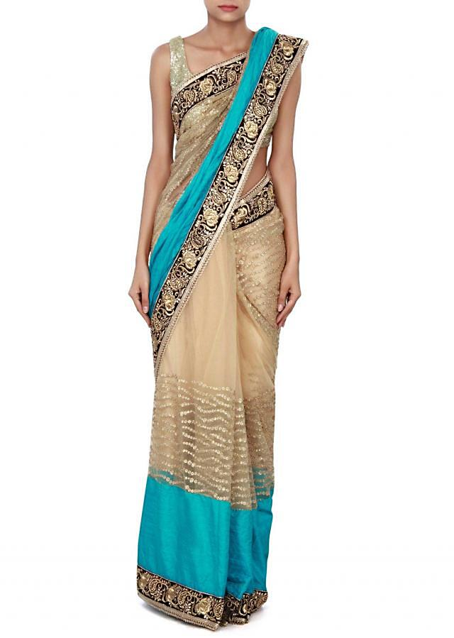 Beige saree adorn in sequin and bold blue silk border only on Kalki