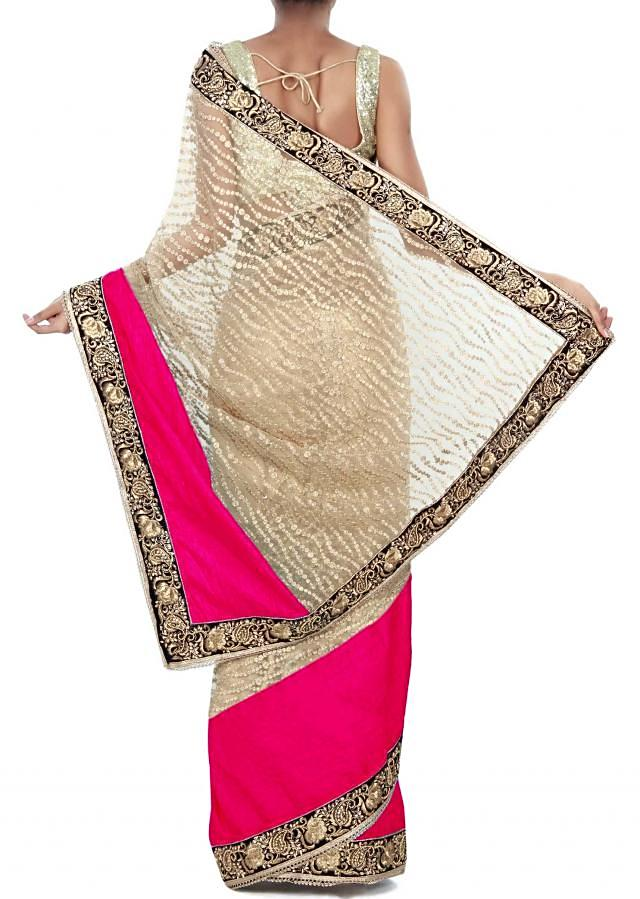 Beige saree adorn in sequin and pink silk border only on Kalki