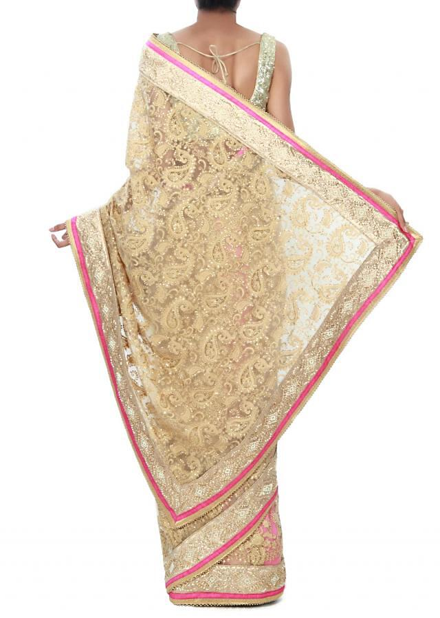 Beige saree adorn in thread and kundan embroidery only on Kalki