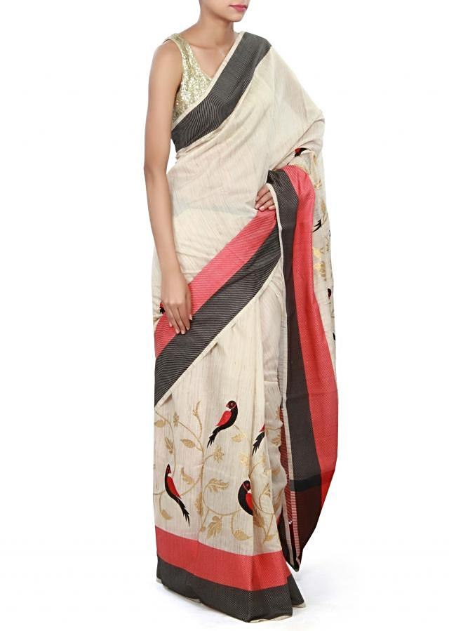 Beige saree featuring in zari and resham embroidery only on Kalki