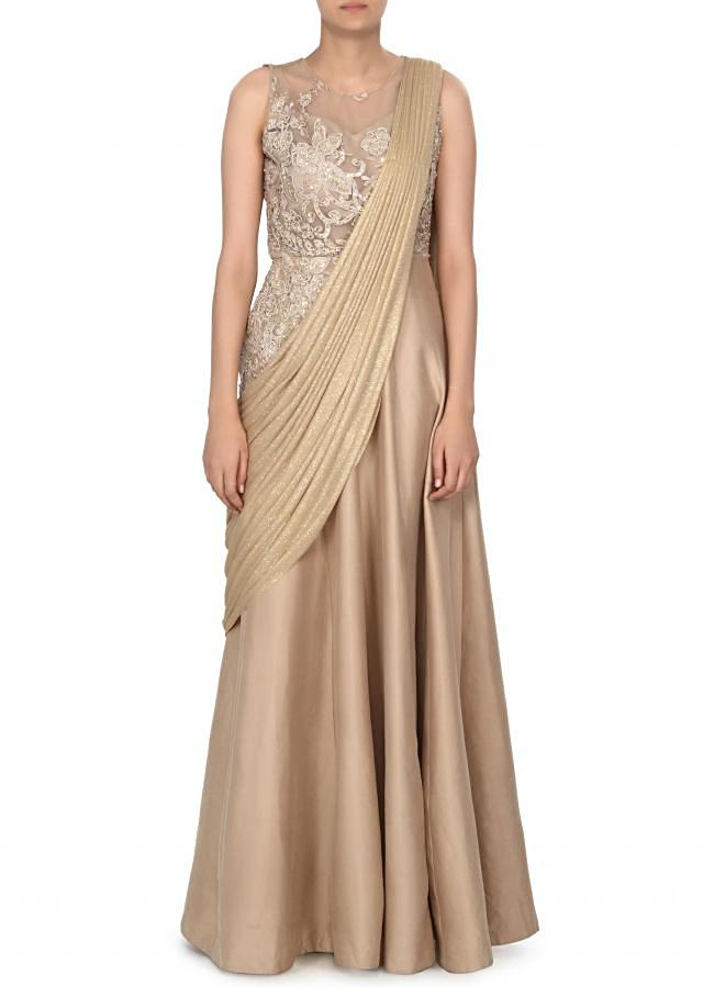 Glittering beige saree gown adorn in floral and resham embroidery only on Kalki