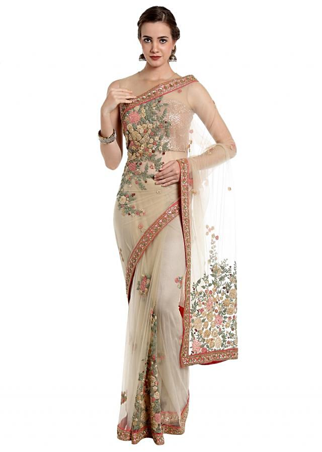 Beige saree in butti and jaal embroidery in floral motif only on Kalki