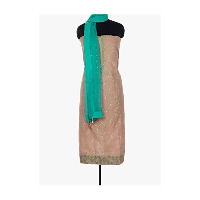 Beige Unstitched Suit With Self Embroidery Paired With Turq Green Bottoms And Dupatta Online - Kalki Fashion